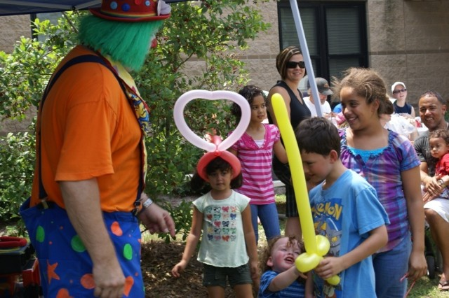 The 96th Civil Affairs Battalion's Slice of Summer event, which took place July 9, featured various sources of entertainment and informative displays, including a clown, which entertained the children by making animal and toy-shaped balloons.