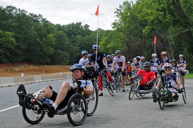 Riders in the State Farm Sea to Shining Sea Ride Across America take off from a rest stop.