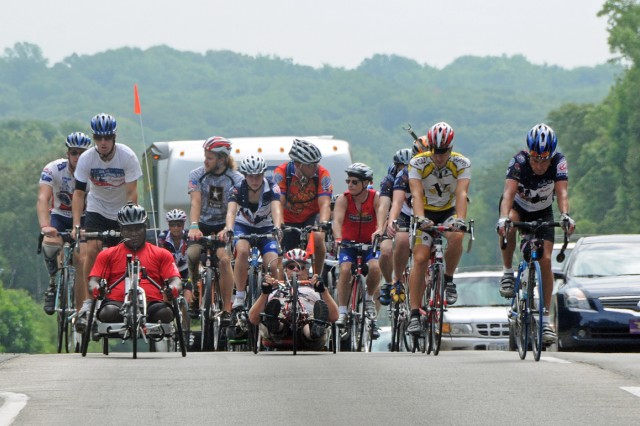 Riders in the State Farm Sea to Shining Sea Ride Across America reach the top of a hill near Fort Belvoir, Va., July 21.