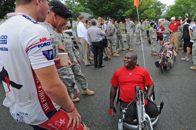 Lt. Col. Greg Gadson talks to Soldiers at Fort Belvoir, Va., July 21. Gadson is one of many riders with a disability undertaking the 4,000 mile trek across the United States.