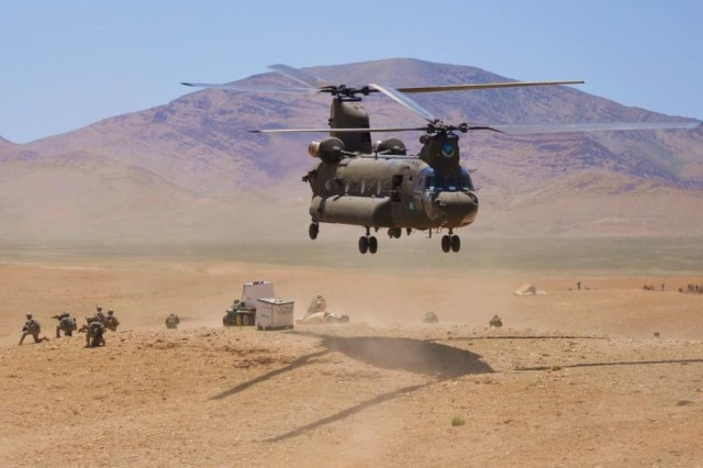 A Chinook helicopter with Task Force Brawler, 3rd Combat Aviation Brigade, Task Force Falcon, lifts off after unloading Soldiers and school supplies in the Logar province, Afghanistan.