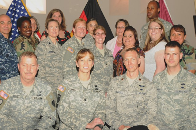 Members of the USAREUR Reintegration and Reintegration Support teams stand together after being recognized at an awards ceremony at Landstuhl Regional Medical Center June 30 for providing 17 isolated, missing, detained or captured personnel a successful transition back to normal life after the strains of captivity.