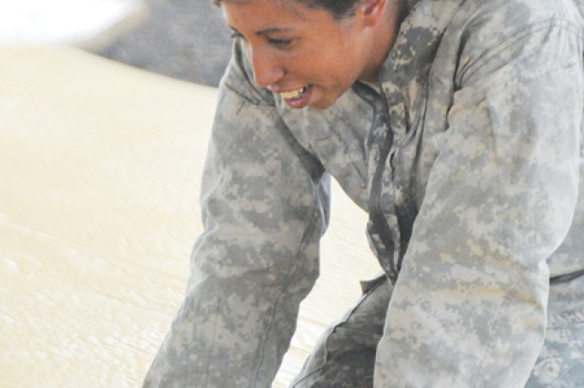 Sgt. Alisha Ricketts takes a breather after combatives training with the 54th Quartermaster Company.