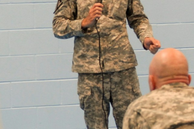 FORT HOOD, Texas-Staff Sgt. James Doyle, the community life non-commissioned officer of Comanche II Village, answers questions from members of the community during a town hall meeting, here, July 20.
