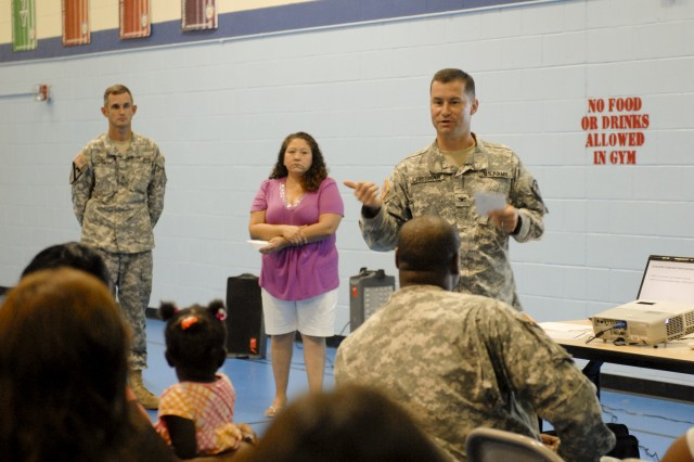 FORT HOOD, Texas-Col. Douglas Crissman, commander, 3rd Brigade Combat Team, 1st Cavalry Division, engages a town hall meeting for Comanche II Village, July 20.