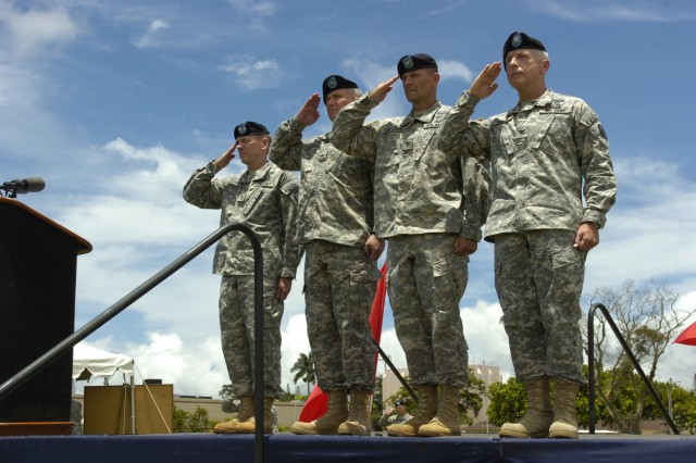 """(From left) Maj. Gen. Bernard S. Champoux, commanding general, 25th Infantry Division; Brig. Gen. Paul J. LaCamera, deputy commanding general - operations, 25th Inf. Div.; Col. Bradley A. Becker, deputy commanding general - support, 25th Inf. Div.; and Col. Bjarne M. Iverson, chief of staff, 25th Inf. Div. render to the National Colors during a """"Flying V Ceremony"""" at Sills Field on Schofield Barracks, July 23. The ceremony welcomed incoming division leaders and their families in preparation for the division's upcoming deployment to Baghdad later this year. (U.S. Army photo by Spc. Jesus J. Aranda, 25th Infantry Division Public Affairs)"""