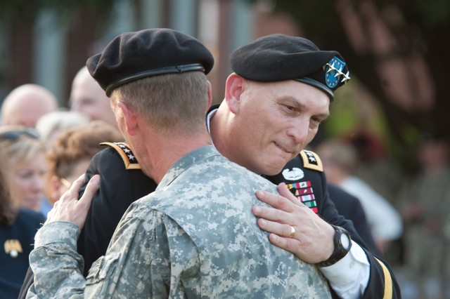 Gen. Ray Odierno, commanding general, United States Forces-Iraq, embraces Gen. Stanley A. McChrystal at the conclusion of McChrystal's retirement ceremony at Fort McNair in Washington, D.C., July 23, 2010. McChrystal  retired from the U.S. Army after 34 years of service to his nation during both peace and war time.