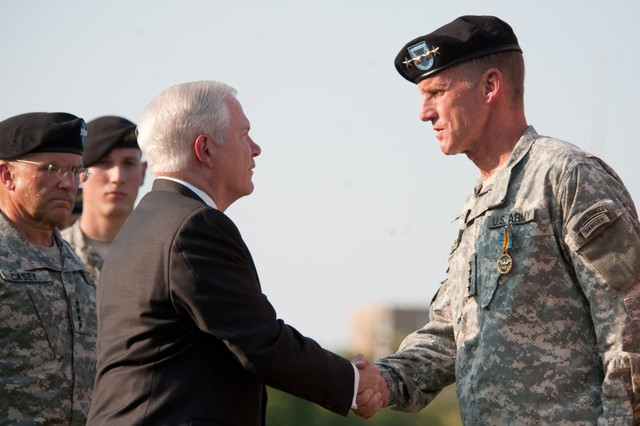 Secretary of Defense Robert Gates shakes hands with Gen. Stanley A. McChrystal after presenting him an award during McChrystal's retirement ceremony at Fort McNair in Washington, D.C., July 23, 2010. McChrystal was lauded as a true warrior, scholar and statesman and an expert at irregular warfare, hybrid warfare, counter-insurgency and counterterrorism.