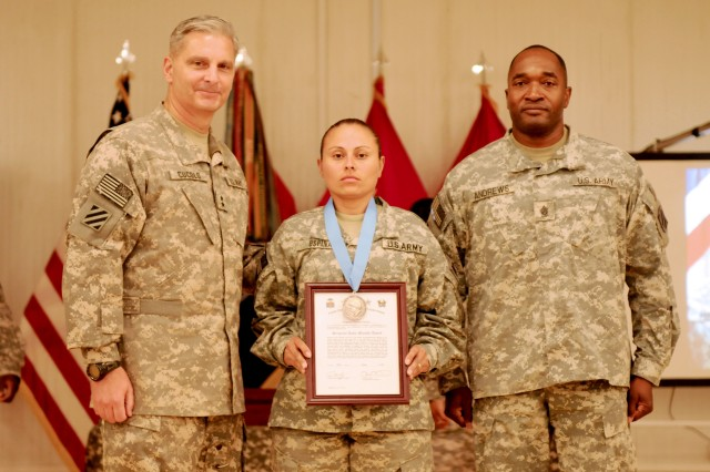 "Task Force Marne Commanding General and Command Sergeant Major, Maj. Gen. Tony Cucolo, and Command Sgt. Maj. Jesse Andrews present the Sgt. Audie Murphy award to Sgt. Sandra Ospina, a military police officer with Headquarters and Headquarters Company, 2-3 Brigade Troops Battalion, 2nd Heavy Brigade Combat Team, 3rd Infantry Division, during the Sgt. Audie Murphy Club and Maj. Gen. Aubrey ""Red"" Newman Award Ceremony, July 22, at the North Morale, Welfare and Recreation building, Contingency Operating Base Speicher, Tikrit, Iraq. (U.S. Army photo by Spc. Cassandra Monroe.)"