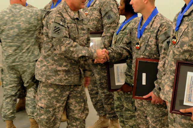 "Task Force Marne Deputy Commanding General Maneuver, Brig. Gen. Patrick J. Donahue II, shakes the hand of recent Maj. Gen. Aubrey ""Red"" Newman Award recipient, Staff Sgt. Aaron Patrick, a Soldier with Delta Company, 2nd Battalion, 7th Infantry, 1st Advise and Assist Brigade, 3rd Infantry Division, after the Sgt. Audie Murphy Club and Maj. Gen. Aubrey ""Red"" Newman Award Ceremony, July 22, at the North Morale, Welfare and Recreation building, Contingency Operating Base Speicher, Tikrit, Iraq. (U.S. Army photo by Spc. Cassandra Monroe.)"