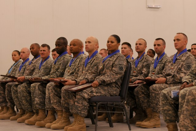 "Inductees of the Sgt. Audie Murphy Club and recipients of the Maj. Gen. Aubrey ""Red"" Newman Award, are seated in their chairs after receiving their awards during the Sgt. Audie Murphy Club and Maj. Gen. Aubrey ""Red"" Newman Award Ceremony, July 22, at the North Morale, Welfare and Recreation building, Contingency Operating Base Speicher, Tikrit, Iraq. (U.S. Army photo by Spc. Cassandra Monroe.)"