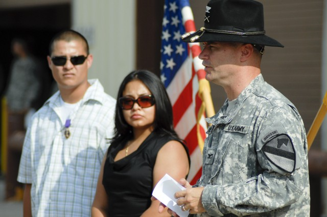 FORT HOOD, Texas - Col. Douglas Crissman, the commander of 3rd Brigade Combat Team, 1st Cavalry Division, presents a speech during a ceremony, here, July 26, to award former Sgt. Juan Castro the Purple Heart Medal for injuries he sustained while serving with D Troop, 6th Squadron, 9th Cavalry Regiment in Diyala province, Iraq in 2007.