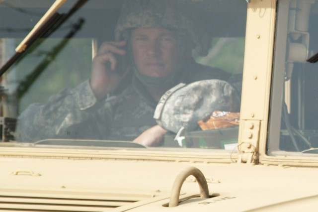 Cpt. Jonathan K. Neal, company commander of the 233rd Transportation Company, monitors the radio communications of the convoy live fire exercise which took place on Fort Knox July 9 and 10. He acted as the sheriff's net, the element which all reports were called in to. (U.S. Army photo by 2nd Lt. Sean Chang)