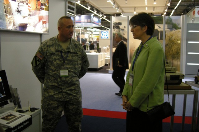Teresa Gerton, Army Materiel Command deputy to the commanding general, visited the booth and discussed the equipment on display with Subject Matter Experts.  Each SME was then presented an AMC command coin by Gerton.