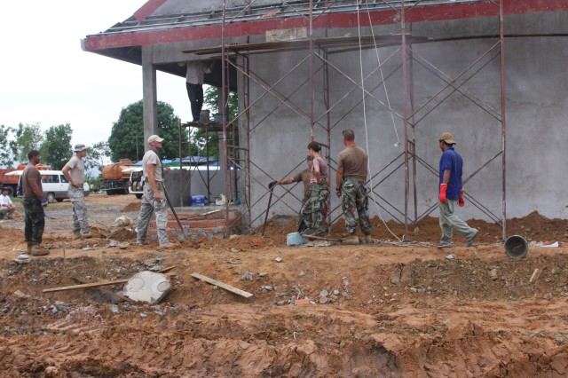 Soldiers from Utah National Guard's 197th Special Troops Company (Airborne) and the Royal Cambodian Armed Forces, as well as Navy Seabees, work together on the school as part of the humanitarian civic assistance project for Angkor Sentinel 2010. Angkor Sentinel is a multinational training exercise supporting peace-support operations co-sponsored by the Royal Cambodian Armed Forces, U.S. Pacific Command and U.S. Army, Pacific.