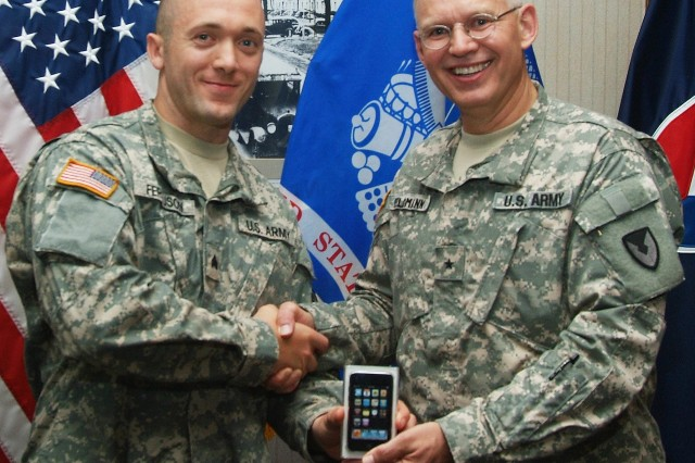 "Sgt. John Ferguson, a security specialist with the Army Sustainment Command Headquarters and Headquarters Company at Rock Island Arsenal, earns the honor of NCO ""Best Warrior"" and is presented with an Ipod touch along with a plaque, sword and gift certificates by Brig. Gen. Steven Feldmann, ASC deputy commanding general for operations. Ferguson competed with seven other Soldiers in a week long competition. He will represent Army Materiel Command at a Department of the Army competition in October."