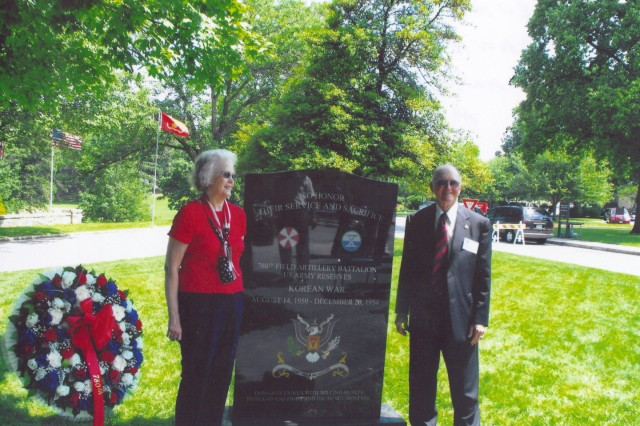 Frank and Joy Kirk stand near the Army Reserve memorial to the 780th Field Artillery Battalion at the dedication ceremony in May 2009. Frank Kirk organized the dedication to the memorial.