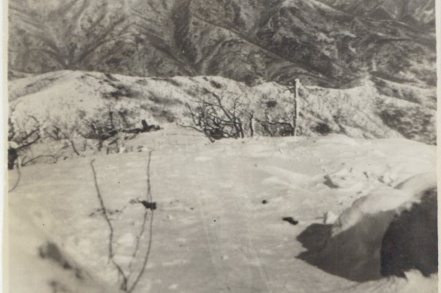 Personal photos from Domenick Lombardi illustrate the harsh wintery conditions Soldiers endured while operating the 8-inch howitzer during fire missions at Kajon-ni in Korea, 1952.