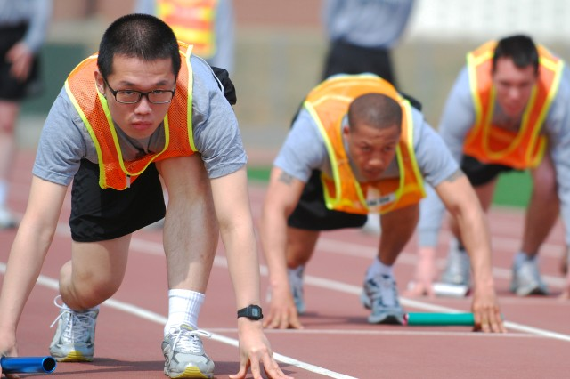Warriors from the 2nd Combat Aviation Brigade get set for a relay race at Camp Humphreys. Aviation and support Soldiers from K-16 Air Base joined colleagues assigned to Camp Humphreys for preliminary competitions.