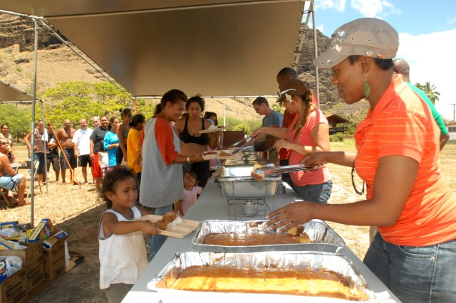 MAKAHA, Hawaii - Laticia Anderson and other volunteers feed homeless families on the island of Oahu as part of REACH, a non-profit charity started by U.S. Army, Pacific Contingency Command Post Operations Sgt. 1st Class Ronnie Russell.
