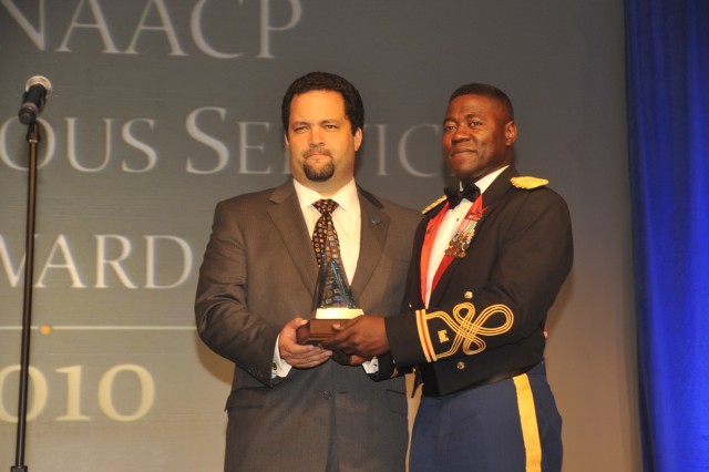 NAACP President and CEO Benjamin T. Jealous presents Col. Barry Williams with the Meritorious Service Award at the NAACP's annual convention. Williams, commander of the 3rd Maneuver Enhancement Brigade in Fort Richardson, Alaska, received the award for extensive volunteering.