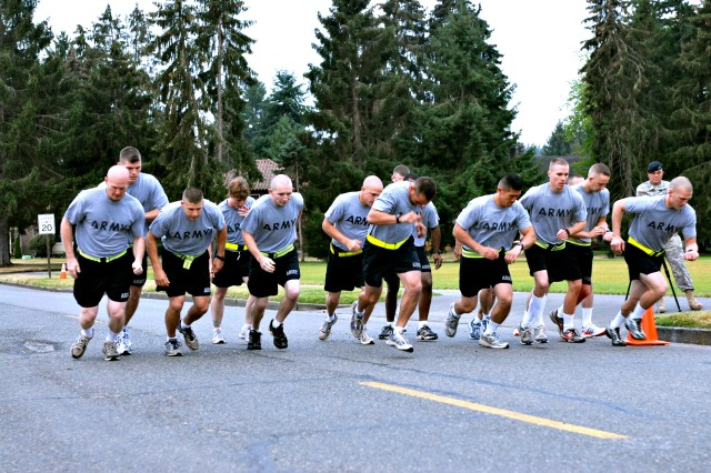 100727-A-2575T-098 Soldiers, competing during the U.S. Forces Command Soldier and Noncommissioned Officer of the Year Competition, push off the starting line during the Army Physical Fitness Test event at Joint Base Lewis-McChord, July 27.  The four-day competition pits eight Soldiers and eight NCOs against one another in order to determine the best of the best from active-duty, National Guard and U.S. Army Reserve Soldiers under U.S. Forces Command.