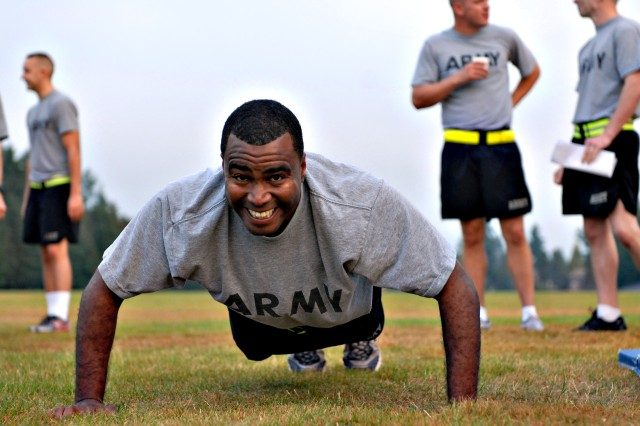 100727-A-2575T-044 Spc. Brian Williams, a combat documentation specialist with the 21st Signal Brigade, who is representing Network Enterprise Technology Command, grits out one last push-up during the Army Physical Fitness Test event at Joint Base Lewis-McChord, July 27.  The four-day competition pits eight Soldiers and eight NCOs against one another in order to determine the best of the best from active-duty, National Guard and U.S. Army Reserve Soldiers under U.S. Forces Command.
