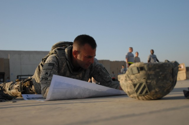 Staff Sgt. Keith Bach, 1st Battalion, 15th Infantry Regiment, 3rd Heavy Brigade Combat Team, 3rd Infantry Division, plots points on a map during the Sergeant Audie Murphy Club board at Contingency Operating Site Kalsu, Iraq. Candidates took a physical fitness test, completed a land navigation course, performed warrior tasks and drills, and answered situational questions asked by senior leaders as part of the board.