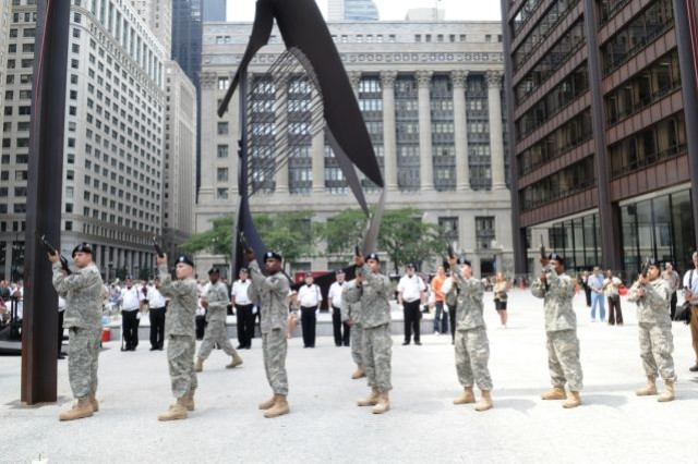 Members of the 933rd Military Police Company, Illinois Army National Guard, execute a 21 Gun Salute as part of the Chicagoland Korean War Veterans, 60th Anniversary of the Korean War Ceremony, July 27, 2010.  The Chicago Council on Human Relations hosted the event at Daley Plaza for about 1,000 attendees.  Supporting the MP Soldiers (behind) are members of the Korean War Veterans Association, South Suburban Chapter, Post 23.
