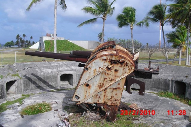 Remnants of a Japanese 5-inch gun emplacement following the invasion on Kwajalein, February 1944.