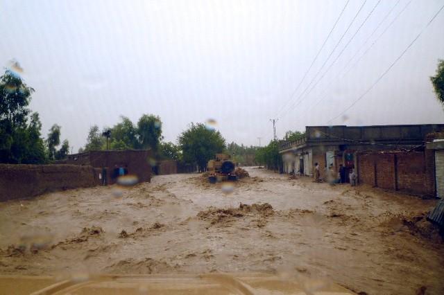 ISAF assesses flood damage