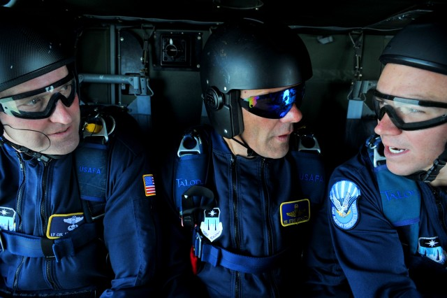 (L to R) Lt. Col. Scott Drinkard, Steve Archuletta and Cadet Jesse Galt, members of the U.S. Air Force Academy Wings of Blue Jump Team, converse during a U.S. Air Force Academy Wings of Blue Jump Team demonstration run July 25. The team will perform at the Boy Scouts of America's 2010 National Scout Jamboree, running July 26 through Aug. 4.