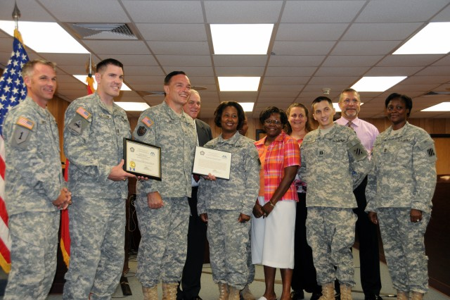 Members of Fort Stewart-Hunter Army Airfield's Office of the Staff Judge Advocate pose with Brig. Gen. Gill Beck, following his presentation of the American Bar Association's Legal Assistance for Military Personnel award to the unit. From left: Lt. Col. Shane Bartee, deputy SJA; Capt. Sean Edlefsen, chief, Legal Assistance; Brig. Gen. Beck, commander, U.S. Army Reserve Legal Command; Russell Putnam, Legal Assistance attorney; Sgt. 1st Class Rosalind Chamberlain, Legal Assistance NCOIC; Staff Sgt. Ignacio Pouncey, Assistant NCOIC of Legal Assistance; Dorothy Andrews, paralegal; Renee Preston, paralegal; Capt. Josh Dimkoff, Legal Assistance attorney; Bruce Anglin, paralegal; and Sgt. Maj. Claudia Turner, 3rd Infantry Division-Rear OSJA Command Paralegal.