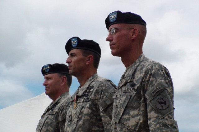 """Lt. Gen. Benjamin R. Mixon, USARPAC commanding general (left) said that outgoing USARPAC Chief of Staff, Col. Arthur T. Ball (center) has performed magnificently.  During a Flying V ceremony on Palm Circle at Fort Shafter, Hawaii, Mixon said that Col. Ball's """"work ethic is renowned throughout the staff.""""  Col. Ball will assume duties as the Pacific Command's Deputy Chief of Staff.  Col. Ball will be replaced at USARPAC by Col. Lewis F. Setliff, III (right), the former Chief of Staff for 8th Army in Korea."""