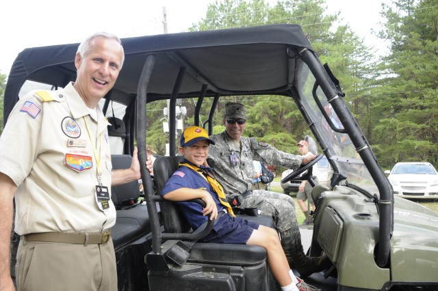 Army Lt. Col John W. Haefner, Fort A.P. Hill commander, his son Luke, pose for a photo with Jim Barbieri, Boy Scouts of America National Scout Jamboree VIP chairman, during the BSA's NSJ July 27. Colonel Haefner spent the morning touring the Southern Region of the Jamboree.