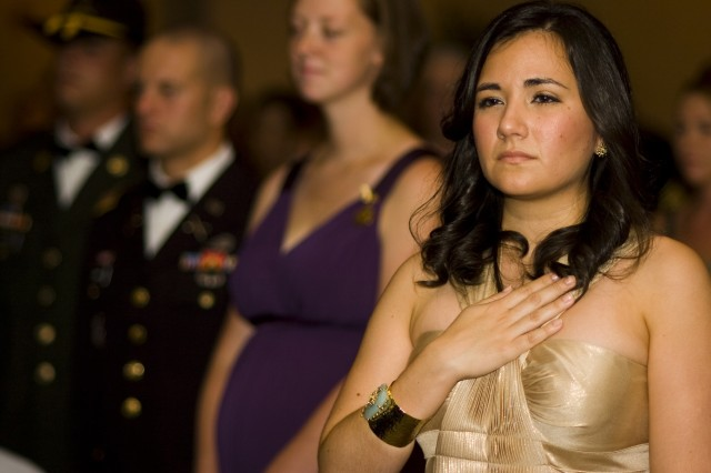 "EL PASO, Texas (July 29, 2010) Christina De La Garza honors America as the national anthem was sung during the opening of 1st Squadron, 13th Cavalry Regiment, 3rd Infantry Brigade Combat Team, 1st Armored Division ""Warhorse"" military ball at the Wyndham El Paso Airport Hotel in El Paso, Texas, July 29. The guest of Capt. Noble Wonsetler, the unit's S-4, De La Garza joined the Warhorse family as they welcomed Sgt. Maj. of the Army Kenneth O. Preston as the night's guest speaker."