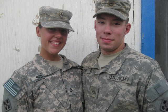 Pfc. Donald and Pfc. Kristina Schmit from Minocqua, Wis., serve as a cavalry scout in Headquarters Troop and a signal support systems specialist in Troop D respectively and are currently deployed to Iraq.