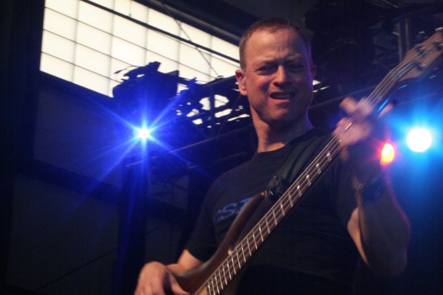 The Lt. Dan Band, including Emmy-award winning actor, Gary Sinise, shown here playing his bass guitar during a concert in Afghanistan Nov. 23, 2009, will welcome Fort Bragg and Pope Air Force Base personnel home from recent deployments by playing a free concert Saturday.