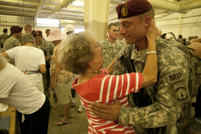 Captain Chuck Stearns embraces his grandmother, Judy Stearns, at Green Ramp Friday. The 16th Military Police Brigade officer was returning from a year's deployment to Afghanistan.