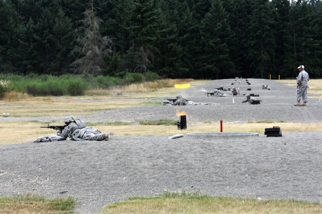 JOINT BASE LEWIS-McCHORD (July 30, 2010) – Eight Soldiers competing in the U.S. Army Forces Command Soldier and Noncommissioned Officer of the Year competition attempt to fire at targets, while mortar simulations go off, during the marksmanship event here July 28.  The four-day Noncommission Officer and Soldier of the Year competition pits eight Soldiers and eight NCOs against one another in order to determine the best of the best from active-component, National Guard and Army Reserve Soldiers within FORSCOM, the Army's largest command.