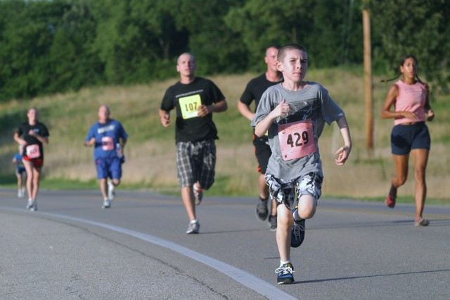 Hunter Calby, 9, runs during the 25th annual 10-5-2 Prairie Run July 24 at Fort Riley, Kan. Calby competed in the 5-mile race, which was the longest he had ever run in a competition.