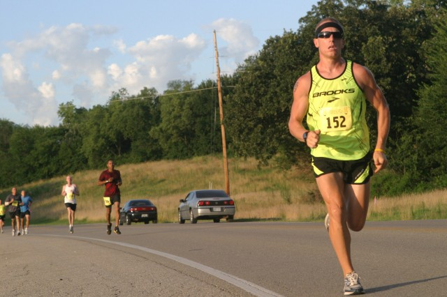 Tim Testa creates separation during the 25th annual 10-5-2 Prairie Run July 24 at Fort Riley. Testa recorded the fastest 10-mile time with a 1:02:20 finish.