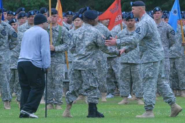 5th Brigade, 2nd Infantry Division's wounded warriors are welcomed back into the ranks during the unit colors uncasing, change of command and reflagging ceremony July 22.