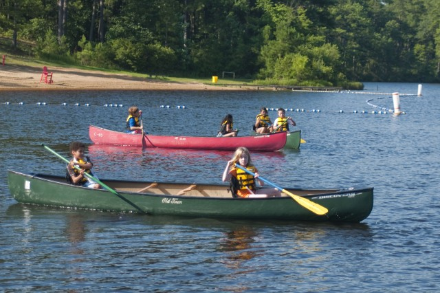Children attending FMWR's Summer Outdoor Fun Camp paddle themselves around Smith Lake, July 22. According to FMWR, the camp is for children 8 to 13 years and fosters team spirit and encourages confidence while building self-esteem.