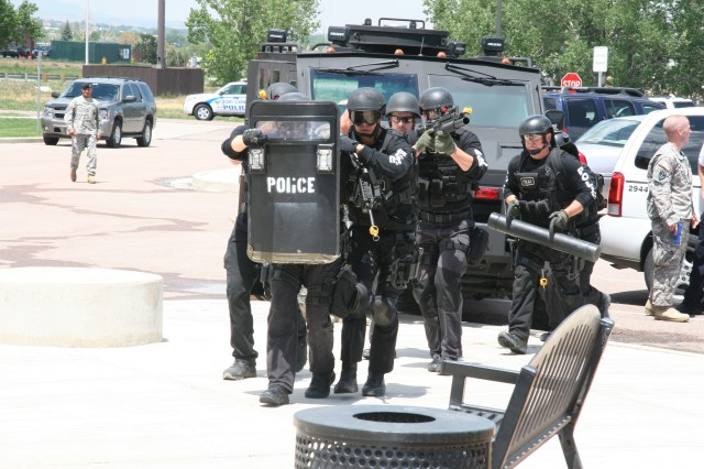 FORT CARSON, Colo.-Fort Carson Special Reaction Team members prepare to enter Carson Middle School during the Mountain Thunder force protection response exercise July 21. The exercise tested police, fire and incident response teams on their hostage crisis and command and control training.