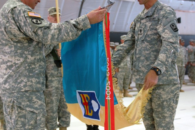 Col. Francisco J. Neuman (left), Ponce, Puerto Rico, commander of Multinational Battle Group East, and Command Sgt. Maj. Gilbert Arocho, Vega Baja, Puerto Rico, command sergeant major of MNBG E, unveil the 92nd Maneuver Enhancement Brigade flag during a Transfer of Authority Ceremony at Camp Bondsteel, Kosovo, July 24. The ceremony marked the change of responsibility to MNBG E from Brig. Gen. Al Dohrmann, Bismarck, N.D., and the 141st MEB to Col. Neuman and the 92nd. (U.S. Army photo by Sgt. Jerry Boffen, 130th PAD)