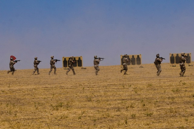 Soldiers from the 2-12th Iraqi Army converge on a target as part of a Combined Arms Live Fire Exercise with U.S. Soldiers from 2nd Heavy Brigade Combat Team, 3rd Infantry Division and 2nd Battalion, 25th Aviation Regiment, 2nd Stryker Advise and Assist Brigade, 25th Infantry Division, in Ninewa province, northern Iraq, July 24.
