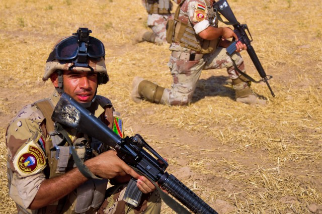 Soldiers from the 2-12th Iraqi Army await orders during a Combined Arms Live Fire Exercise with U.S. Soldiers from 2nd Heavy Brigade Combat Team, 3rd Infantry Division and 2nd Battalion, 25th Aviation Regiment, 2nd Stryker Advise and Assist Brigade, 25th Infantry Division, in Ninewa province, northern Iraq, July 24.