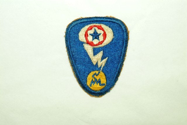 Manhattan Project shoulder sleeve insignia belonging to Technician Richard Echert who was assigned to the Special Engineering Department. (Army Heritage Museum; Photographer: Kaleb Dissinger).