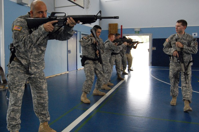 Sgt. Jeremiah D. Sutton, (right) a U.S. Army Garrison Brussels Military Policeman, reviews proper weapons techniques during active shooter training on July 26.